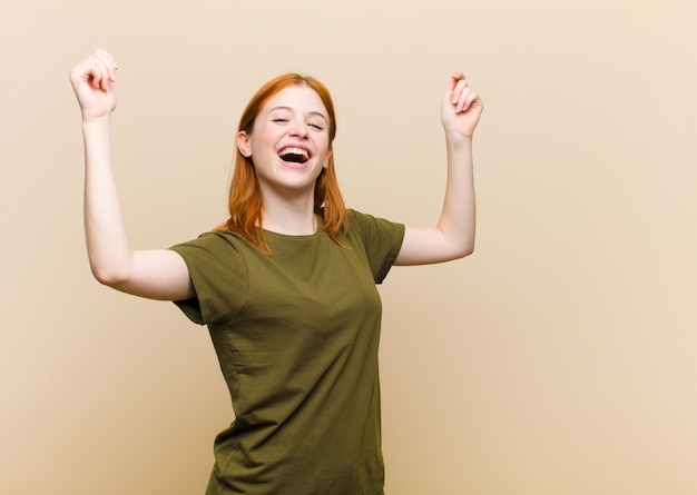 Shouting triumphantly, looking like excited, happy and surprised winner, celebrating
