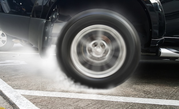 Show burning tires racing car in racetracks
