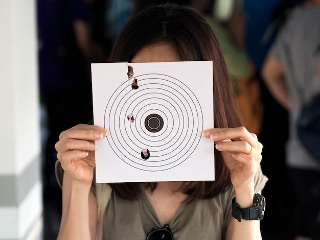 Show target by shooting gun