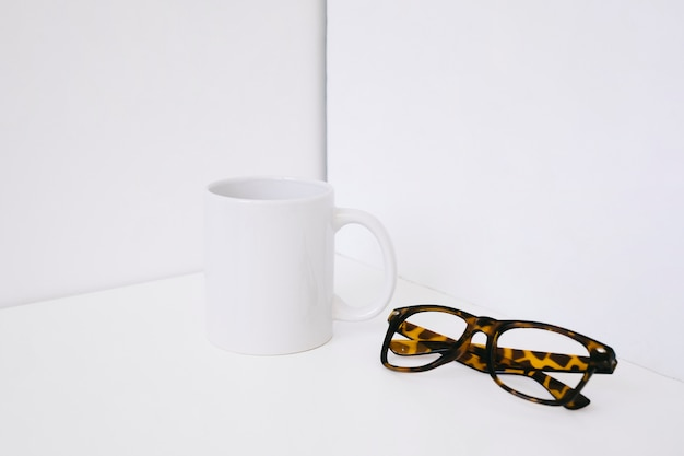 Showcase concept with mug and glasses