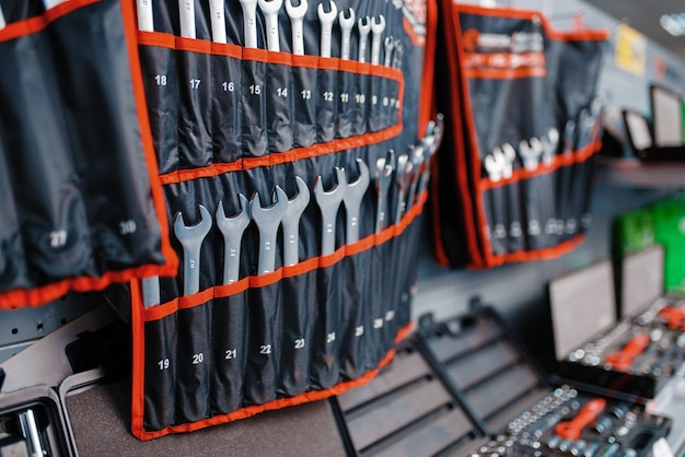Showcase with wrenches kits in tool store closeup