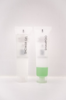 Shower gel and a green shampoo bottles