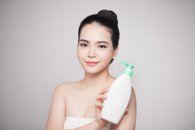 Shower gel. joyful young woman advertising care product.