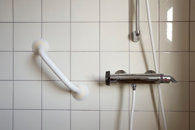 Shower and handrail grab bar for elderly people at the bathroom in hospital or retirement home