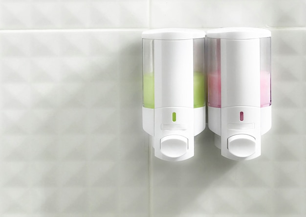 Shower and shampoo bottle on wall