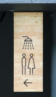 Shower sign on wood board