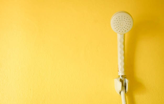 Shower  on the yellow wall