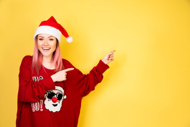 Showing girl with red santa suit