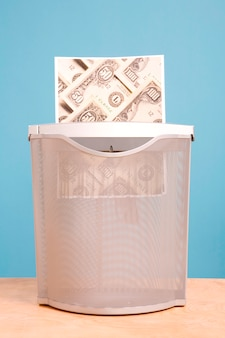 Shredding money in effigy