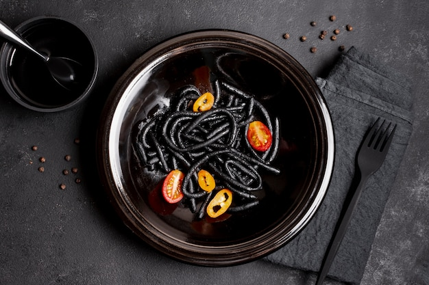 Shrimp black pasta in plate with fork and soy sauce
