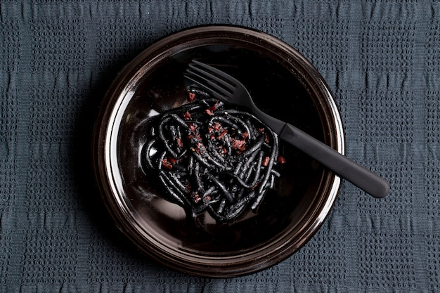 Shrimp black pasta with fork top view
