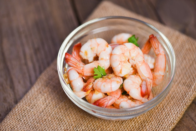 Shrimp delicious seasoning spices on glass bowl and wooden table background cooked shrimps or prawns, seafood selfish