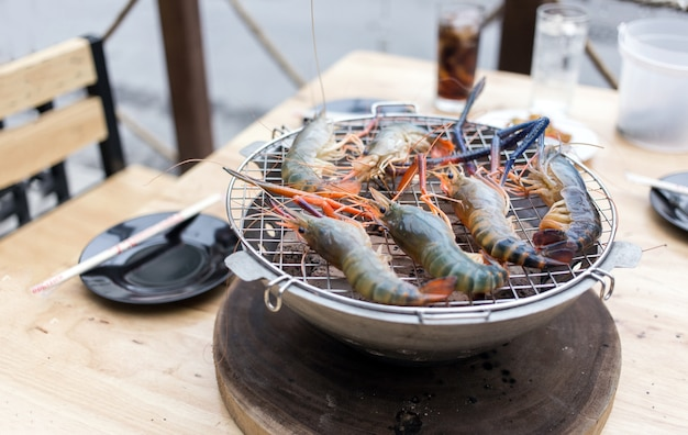 Shrimp grill on chacoal barbecue on table