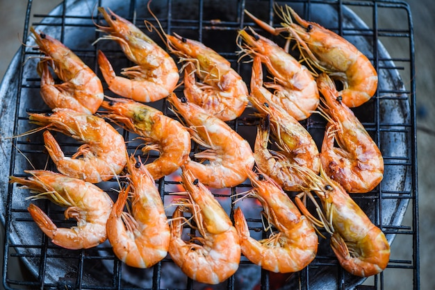 Shrimp grilled bbq seafood on stove prawns shrimps cooked burnt on grill barbecue