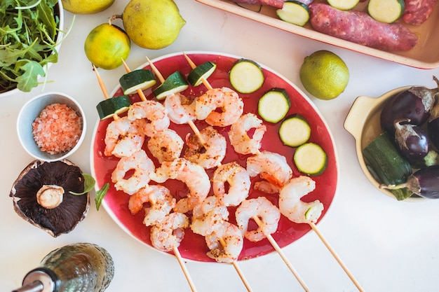 Shrimp kebabs served with vegetables and fruits