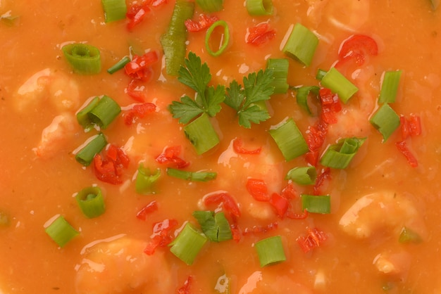 Shrimp moqueca with chives, parsley and pepper
