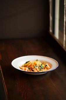 Shrimp pasta noodles on wooden counter