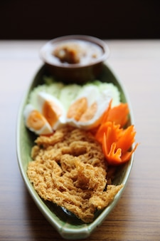 Shrimp paste sauce with crispy fried fish and egg