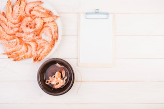 Shrimp plate with clipboard on table