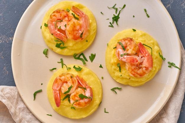 Shrimp & polenta - fodmap dash diet gluten free dish, top view closeup