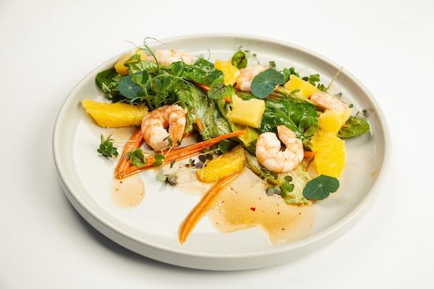 Shrimp salad in soy-ginger dressing on a plate.
