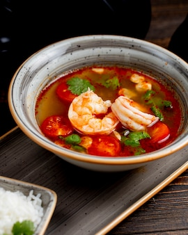 Shrimp soup with tomatoes and greens
