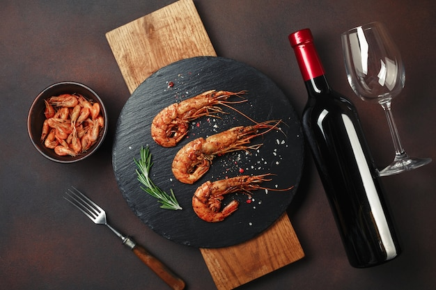 Shrimp with bottle wine on rusty