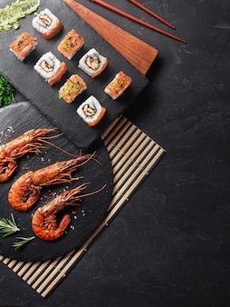 Shrimp with sushi on stone table