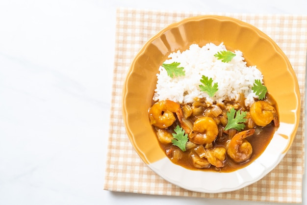 Shrimps in curry sauce on rice
