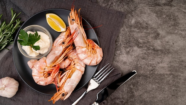 Shrimps on plate in flat lay