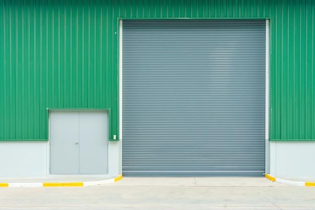 Shutter door or roller door and concrete floor outside factory building