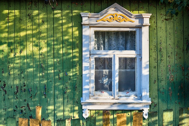 Shutters of an old window with a pattern of a rustic old house in a vintage style