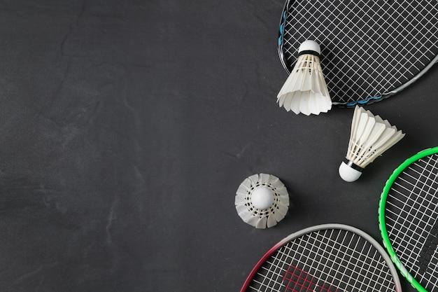 Shuttlecocks and badminton racket on black background.sport concept, concept winner, copy space imag
