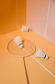 Shuttlecocks and badminton racket high angle