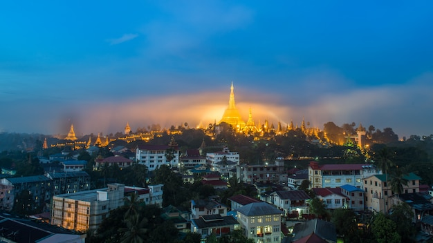 Shwedagon paya pagoda in gold mist in the morning before sunrise