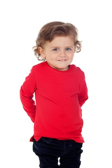 Shy baby with two years wearing red t-shirt