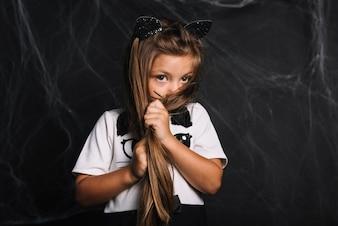 Shy girl in cat costume