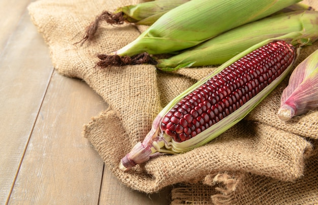Siam ruby queen corn on wood background,