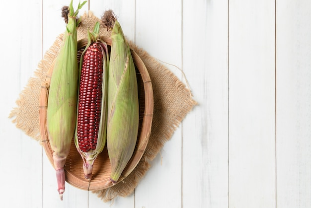 Siam ruby queen corn on wood background.