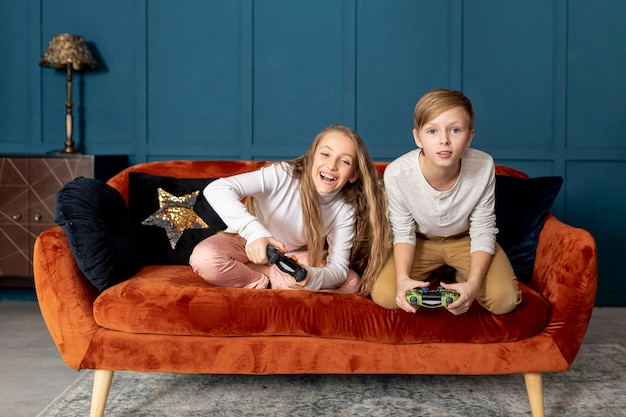 Sibling playing together video games