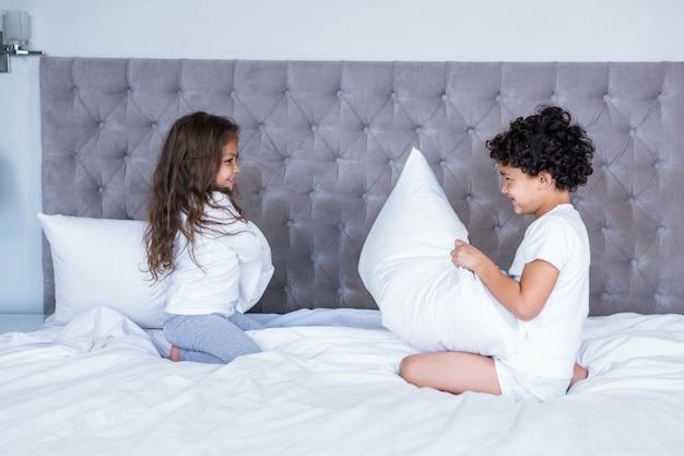 Siblings pillow fighting