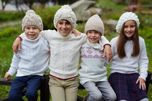 Siblings posing in countryside