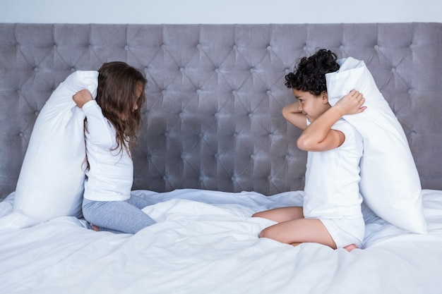 Siblings ready for pillow fight
