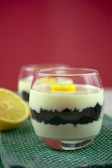 Sicilian lemon cream and cookies verrine over red background