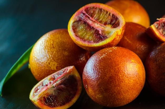 Sicilian oranges close-up on a black background