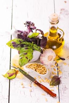 Sicilian pesto ingredients on wooden table.