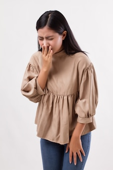 Sick, allergic woman sneezing with cold or allergy