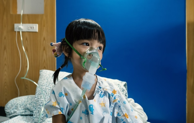 A sick asian kid girl fumigated through her nose to kill lung sterilization.