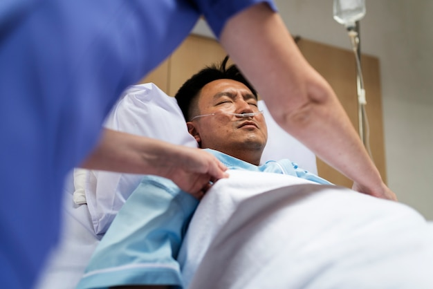A sick asian man in the hospital