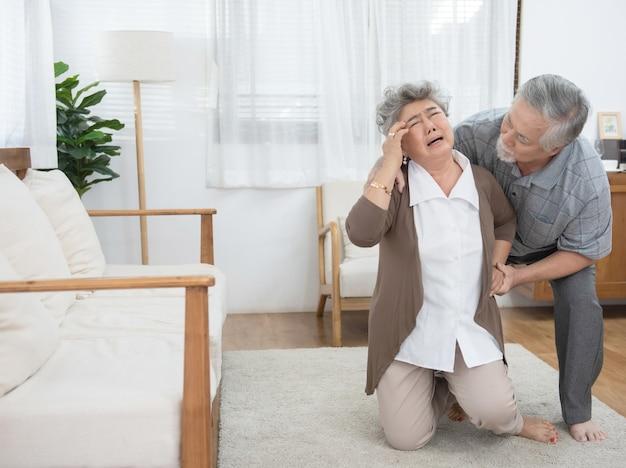 Sick asian senior woman fainted and fallen on floor